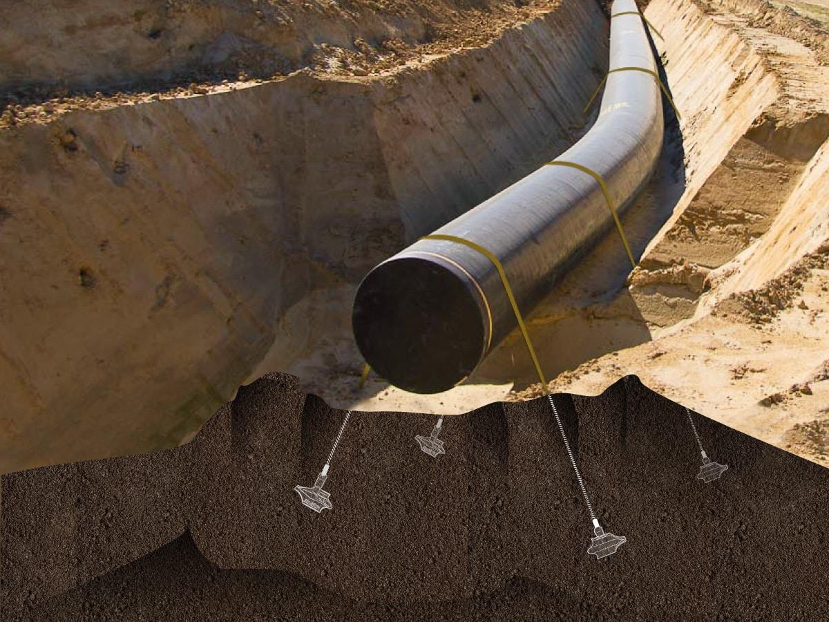 Illustration de l'ancrage d'une conduite souterraine avec le système d'ancrage au sol Platipus