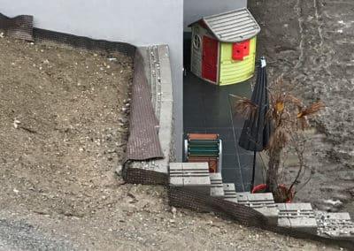 Travaux d'ancrage d'un mur de jardin à Veyras