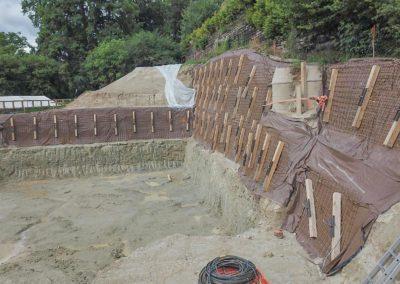 Blindage d'une paroi d'excavation verticale avec le système d'ancrage Platipus