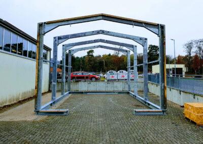 Ancrage permanent d'une tente de stockage avec le système d'ancrage Platipus